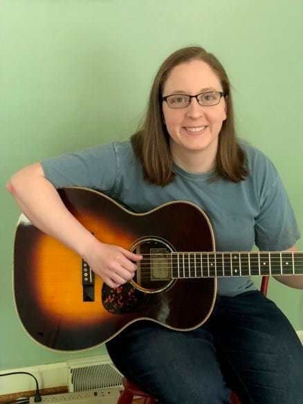 Hendersonville dentist playing some guitar for her patients