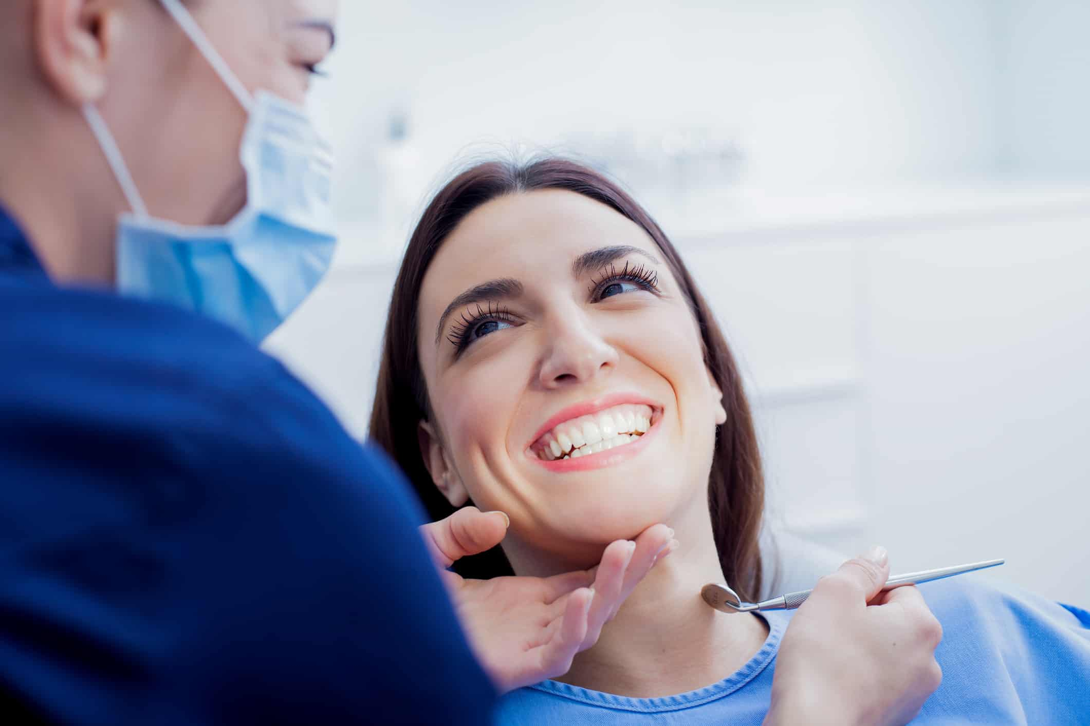 Woman smiling with her dentist during routine teeth cleaning in Hendersonville